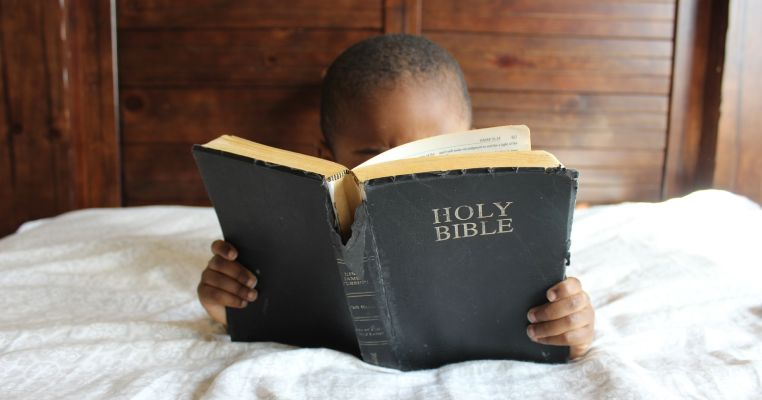 foster child reading bible